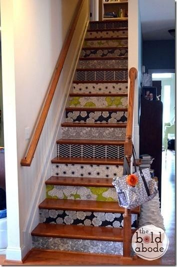 Place Removable wallpaper on stair risers for an easy way to add pattern to your hallway.