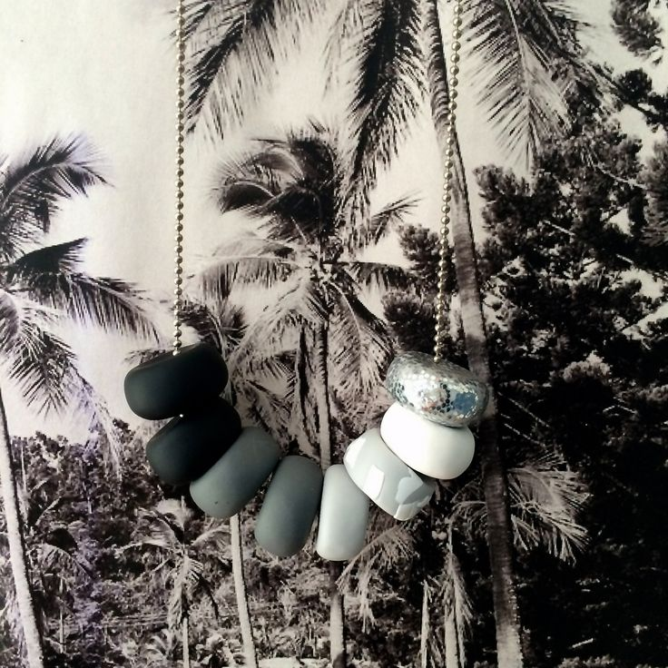 Luna - Shades of classic black, grey   white Azure - Shades of calming blues   greensSplice - Shades of tropical lime   pinksAll strung onto a silver steel ball chain and hangs approx just below the bust line.