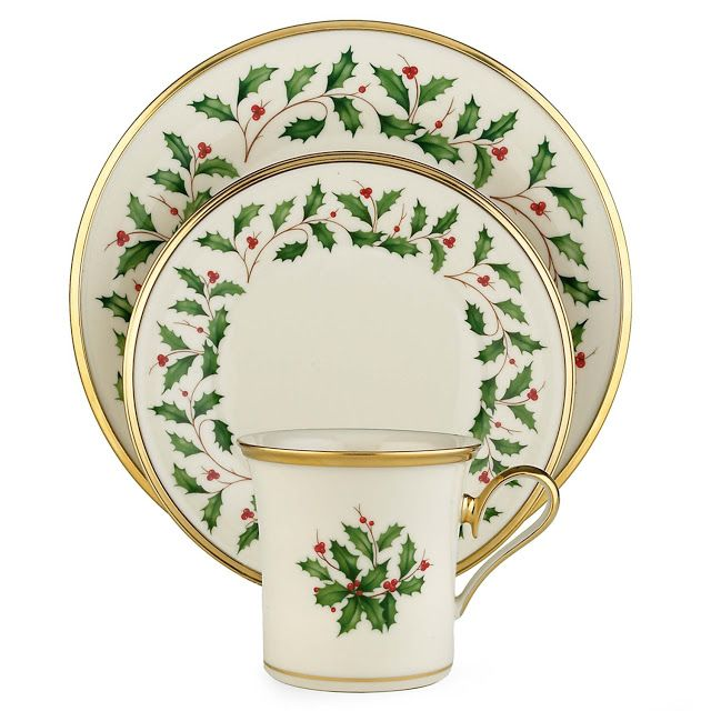 This Lennox 12-piece Dinnerware set is absolutely stunning.  This dinner set is crafted from Lenox ivory bone china with a 24-karat gold band. The pattern features a white ivory background with a wreath of bright green holly and red berries.