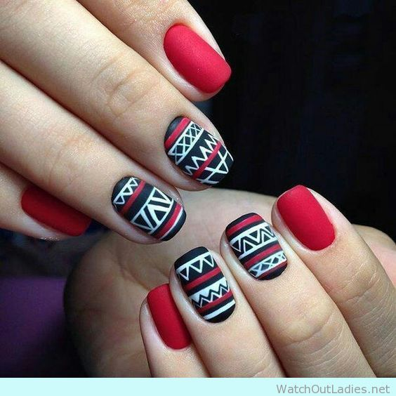 Chevron nail design with red nail accents