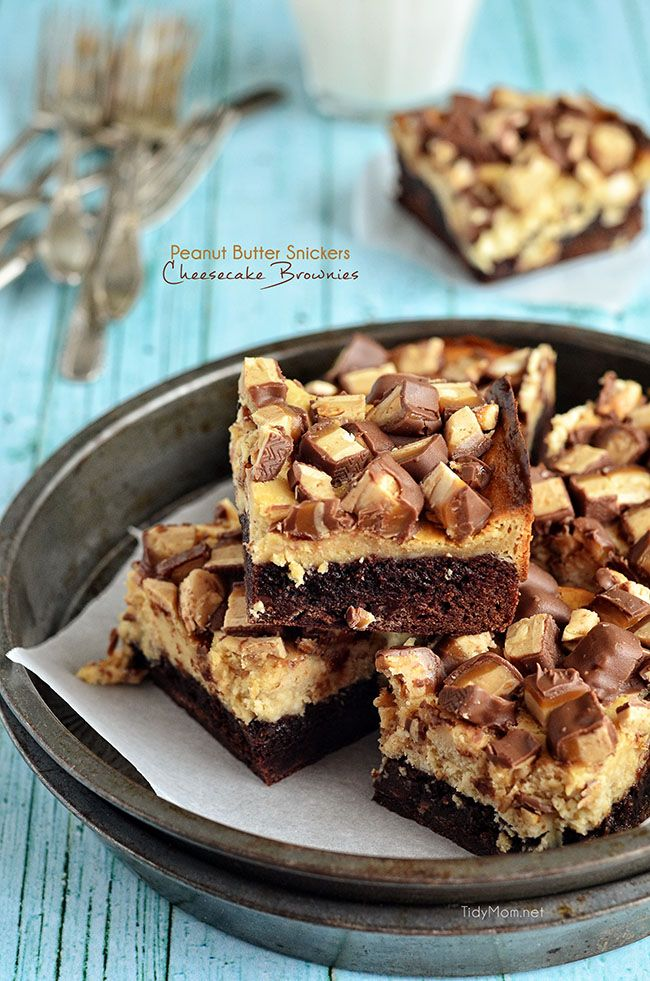 Peanut Butter Snickers Cheesecake Brownies absolutely sinful, just the way a brownie should be! recipe at TidyMom.net