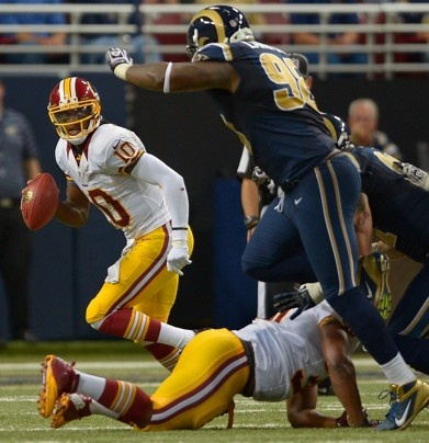 Robert Griffin III evades Rams defensive tackle Kendall Langford during a Week 2 loss in St. Louis.  John McDonnell / The Washington Post