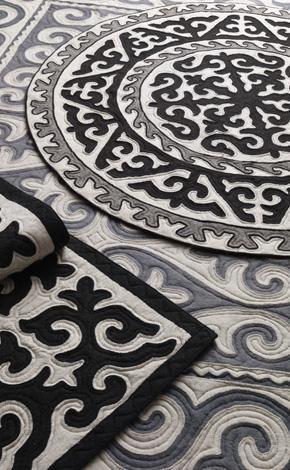 Felt art - shyrdak   ICI.. love the traditional patterns...  also could do zentangles?