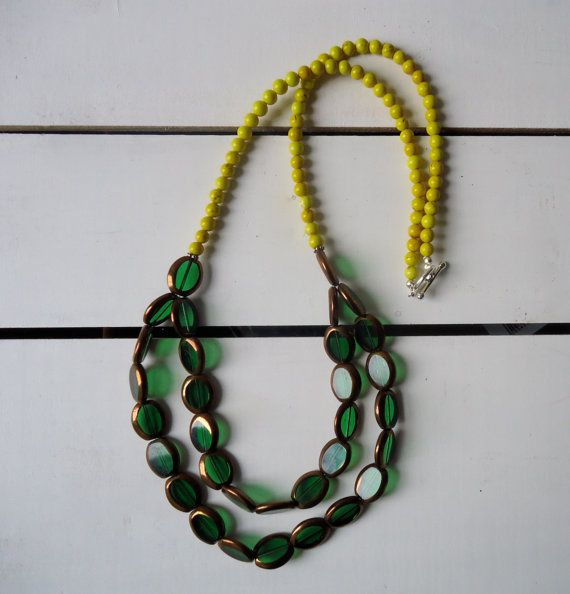 Mackintosh: A necklace in clear green and gold glass with semi precious yellow stones.