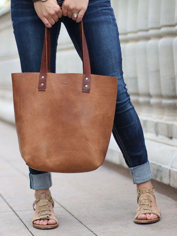 The Ashley Tote Fine Leather Handbag 100% Made in USA from Full Grain Leather.   Perfect for holding your books, laptop, and other essentials.