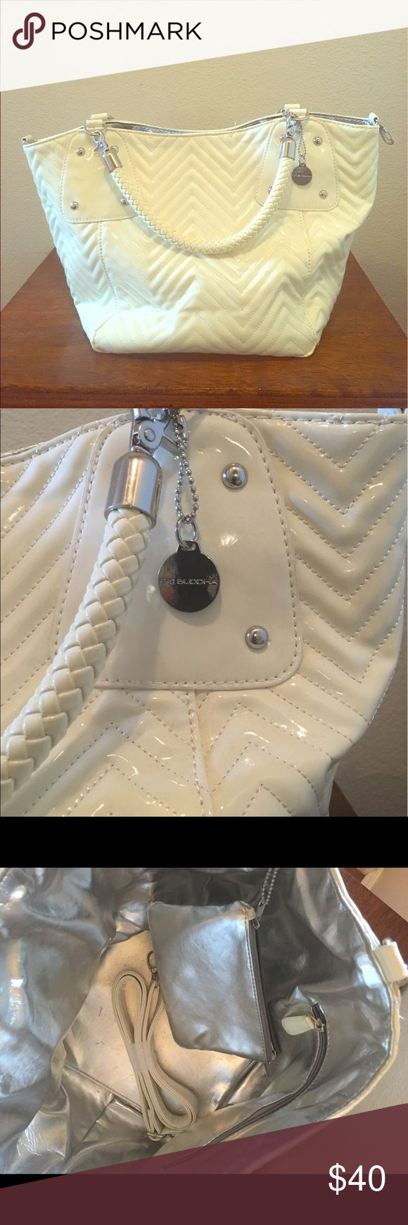 Big Buddha Faux Leather White Quilted handbag Big Buddha White Faux Leather Quilted Embossed style/ silver accents/ silver accessory bag/ shoulder strap and braided drop handle.  Silver satin lining.  Almost brand new. Big Buddha Bags Shoulder Bags