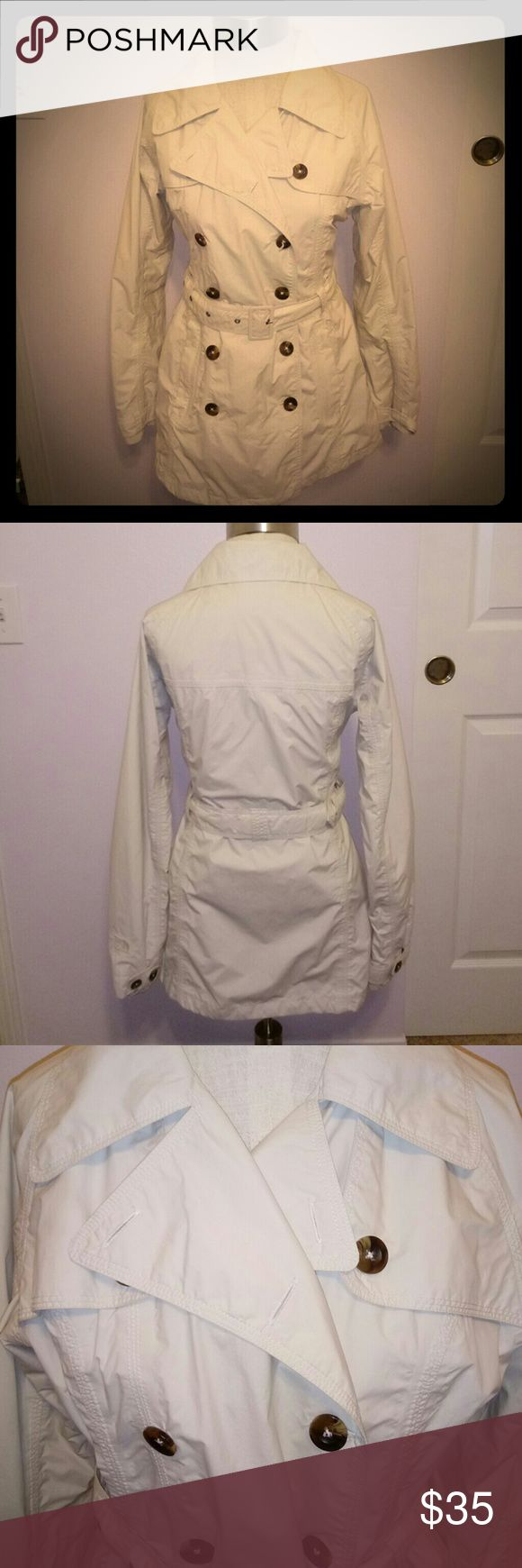 THE NORTH FACE Belted Women's Rain Jacket Color: Cream. Shell: 100% Nylon. Lining: 100% Polyester. No flaws, rips or stains. Belt is adjustable. No missing buttons. Size M. Feel free to ask questions or make an offer. GUC. North Face Jackets & Coats Pea Coats