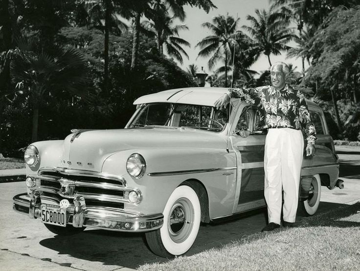Duke Kahanamoku poses with his brand new Dodge woodie station wagon on the grounds of the Royal Hawaiian Hotel in 1950. Duke traveled in person to the factory in Detroit to purchase this car. Image from Bishop Museum Archives, Honolulu, Hawaii.