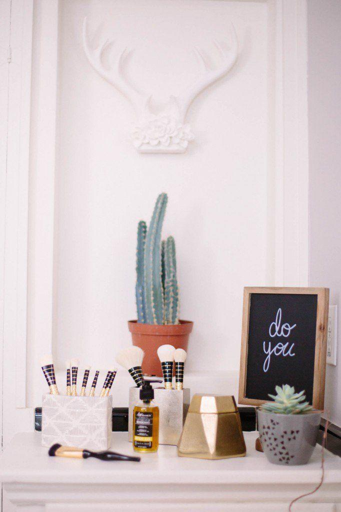 DIY Beauty Oasis Bathroom Makeover | Makeup brushes in a toothbrush holder & chalkboard art