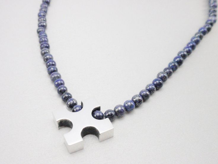 Cruz con collar de Lapizlazuli