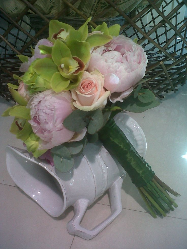 Bridal bouquet made with Green Beauty roses,pink peonies,Senorita roses and green cymbidium orchid