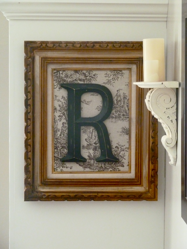 "Old picture frame, fabric, and plastic ""R"""