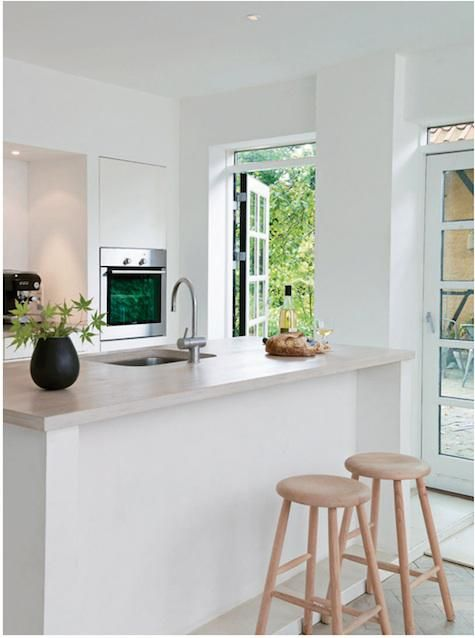 love the clean minimalistic kitchen with plenty of doors leading out.Lights, The Doors, Cleaning Windows, Kitchens Ideas, Interiors Design, White Cabinets, Kitchens Doors, Stools, White Kitchens