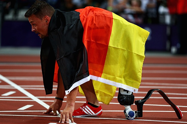Heinrich Popow of Germany takes a moment on the start line after winning the gold medal in the men's 100m T42 on Day 9 of the London 2012 Paralympic Games at the Olympic Stadium (Photo by Dean Mouhtaropoulos/Getty Images)
