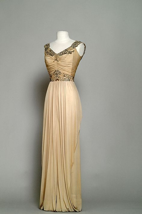 Costume designed by Edith Head for Anne Baxter in All About Eve (1950).  From the Bibliotheque du Film