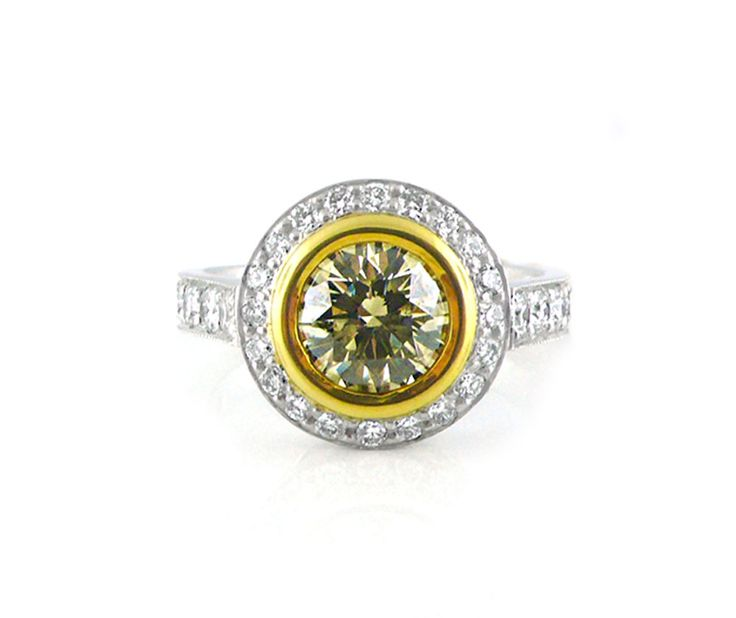 An 18ct White and Yellow Gold, Fancy Brown Round Brilliant Cut Diamond Halo Ring