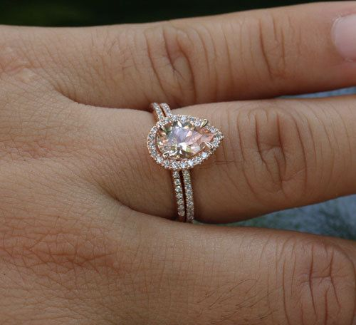 This Stunning delicate and feminine 14k Gold Single Halo Ring Features a flawless Natural Morganite Pear measuring 9x6mm and surrounded with Natural Diamonds. The Diamonds go halfway round the band. This listing is for the Morganite Ring as well as a Matching Half Eternity Diamond Band. If you would like any other Gemstone set in this Ring, please convo me. Please read my CUSTOM ORDER Section for further information. Details of Engagement Ring Solid 14k Rose Gold(shown in picture) Natural…