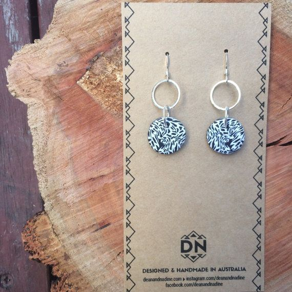 You are looking for a super cool earring that will stand out from the crowd but you can wear everyday, these are a great choice! They are a shorter style with a classic double circle design.MAT...
