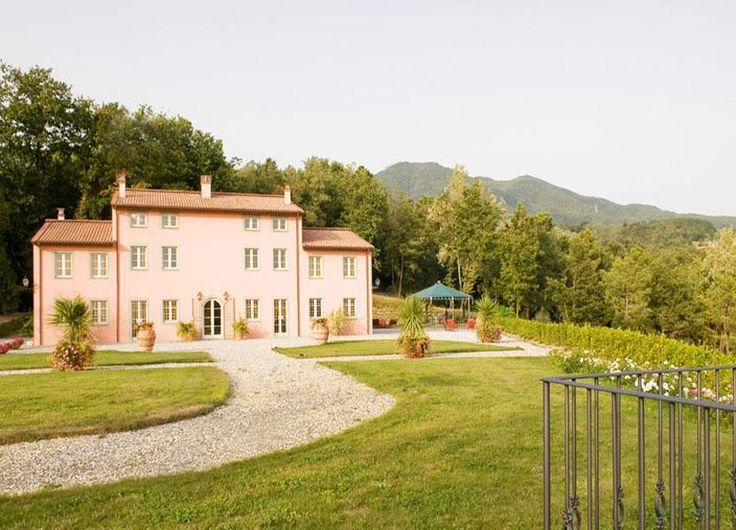Long view of the villa and garden