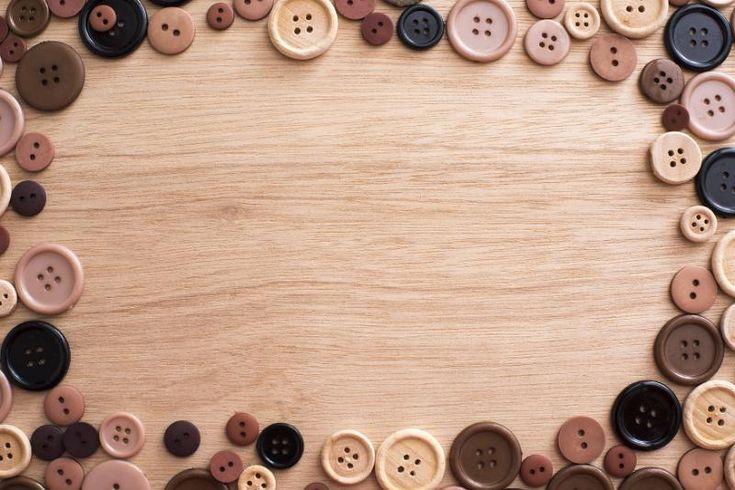 Fashion frame of assorted brown toned buttons on a wooden background with copy space viewed from above - free stock photo from www.freeimages.co.uk