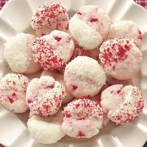 """Dipped Cherry Cookies Recipe -Our seven children and four grandkids voted this festive, flavorful cookie a """"keeper."""" We gave a batch to our mail carrier, in thanks for trudging through so much snow, and she asked for the recipe. —Ruth Anne Dale, Titusville, Pennsylvania"""