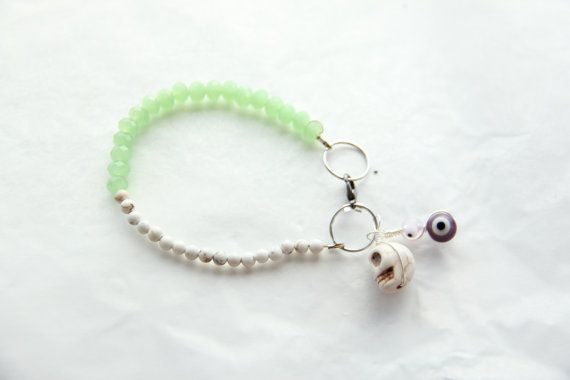 Opal green coloured crystal and Howlite bead  charm bracelet by Somsri, $18.00 #somsri #Jewelry #Jewellery #Stone #Crystal #Handmade #Handmadejewellery #Handmadejewelry #Gemstone  #Green #Greenbracelet  #Howlite  #Skull #Beaded #Bracelet #Beadedbracelet #Crystalbeads #Evileye