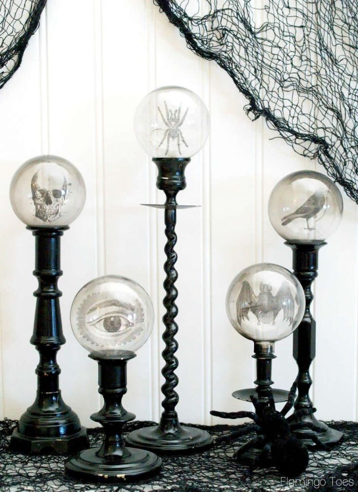 Spooky Crystal Ball Halloween Candlesticks.... Simple... and you could make designs for any holiday or just for decor.