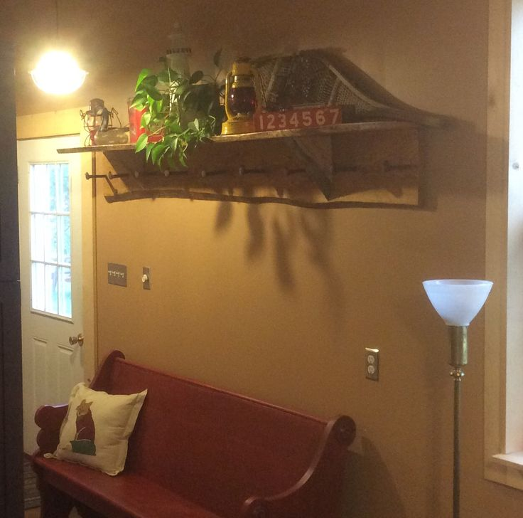 Live edge pine shelf made from Bob's saw mill with railway spikes for coat hooks.