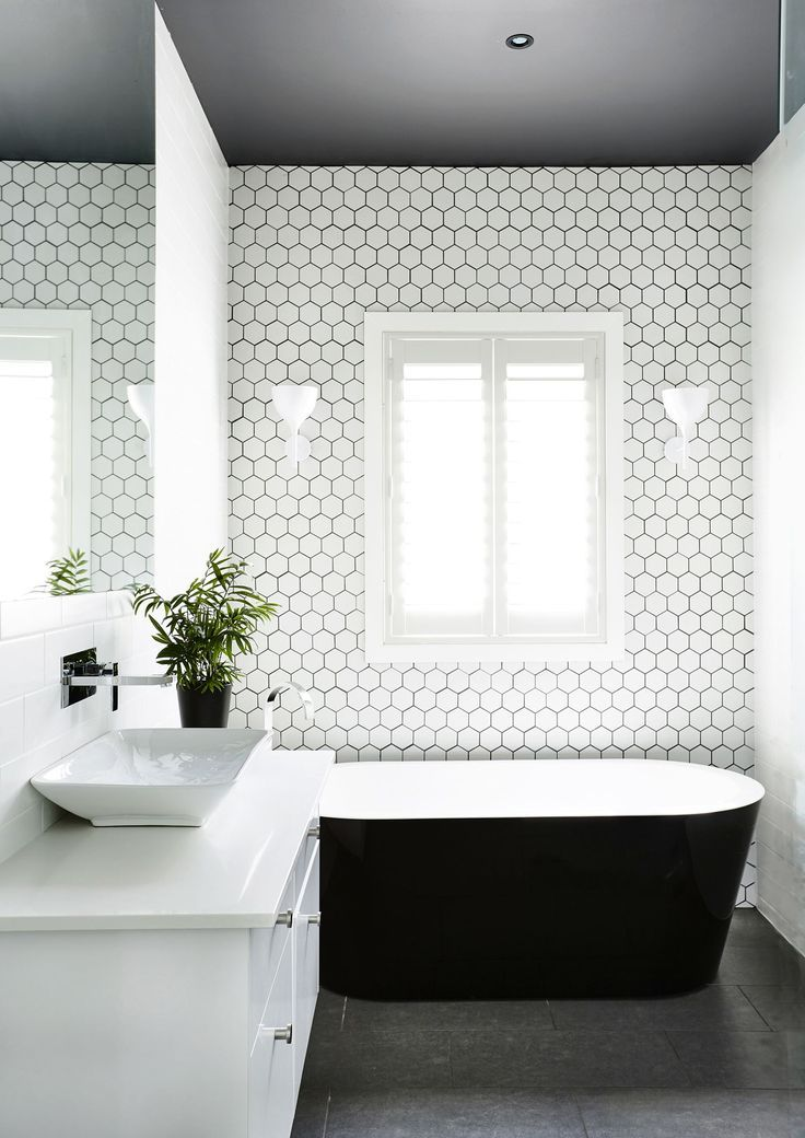 """The dark ceiling was inspired by a project on *The Block*. """"It gives the bathroom a cosy feel, with a little bit of drama,"""" Marilla says. **Basin** and **tapware** from [Swan Street Sales](http://www.swanstreet.com.au/?utm_campaign=supplier/