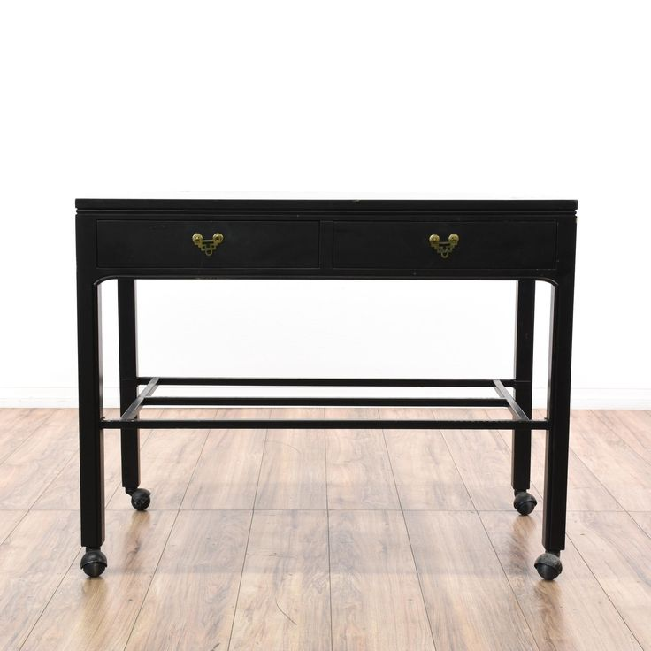This asian bar server cart is featured in a wood with a glossy black paint finish. This console table has 2 drawers, a bottom rack shelf and rolling wheel feet. Perfect as a sideboard buffet for serving drinks and dishes! #asian #tables #consoletable #sandiegovintage #vintagefurniture