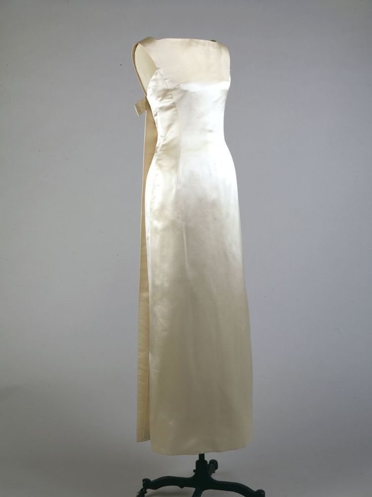 Jackie Kennedy Ivory Evening Dress by Oleg Cassini,This dress was worn by First Lady Jacqueline Kennedy to a fundraiser celebrating the first anniversary of the Kennedy Inauguration at the National Guard Armory in Washington, DC on January 20, 1962. The First Lady also wore this gown to a dinner in her honor in New Delhi, India on March 13, 1962.