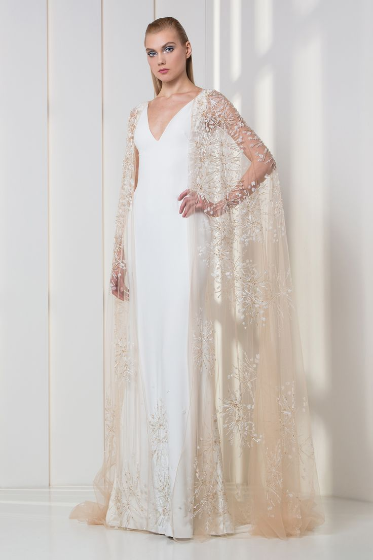 Tony Ward RTW FW 17/18 I Style 10 I White crepe dress with V-neckline, with sequins embroideries on the hemline and a nude embroidered cape