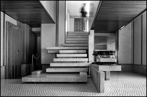 The Olivetti Showroom was designed in 1957 by Carlo Scarpa.  Carlo Scarpa (1906-1978) was an Italian architect. He studied at Accademia di Belle Arti, earning a degree in architectural drawing in 1926.From 1933 to 1947 he consulted for Venini, a Venetian glass manufacturer.  In the late 1950s Adriano Olivetti commissioned Scarpa to design a display space for his Olivetti products. The resulting Olivetti Showroom was used for decades by Olivetti before changing owners.