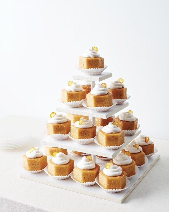 These mini hexagonal orange pound cakes have a honey glaze, whipped cream, and candied kumquat slices.
