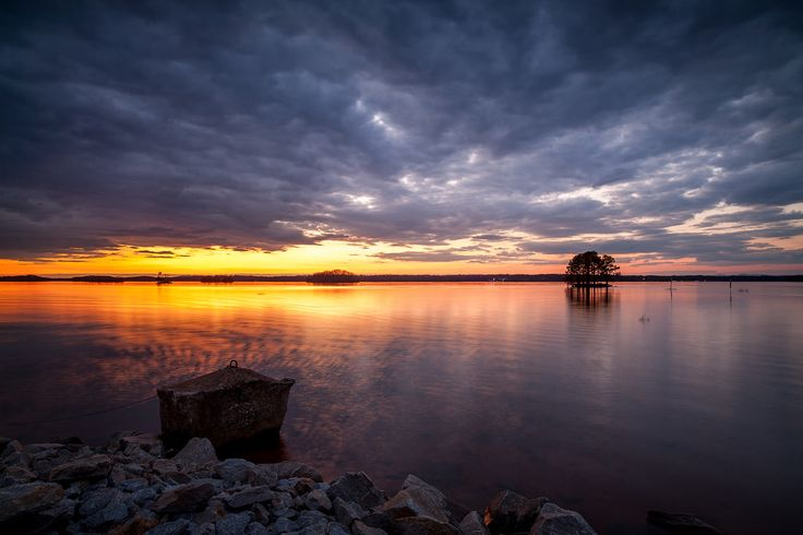 John Cothron posted a photo:  This is an sunset image taken at Old Federal Park on the eastern shore of Lake Lanier near Flowery Branch, GA. The concrete anchor in the image is used to anchor one end of a string of buoys that mark off the swimming area. (5.0 sec at f/11) ©John Cothron 2010  If you are interested in licensing any of my images, please feel free to contact me via email.
