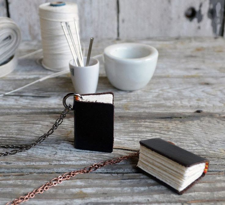 http://vintagesproduct.blogspot.com/2014/03/handmade-leather-mini-books-necklaces.html