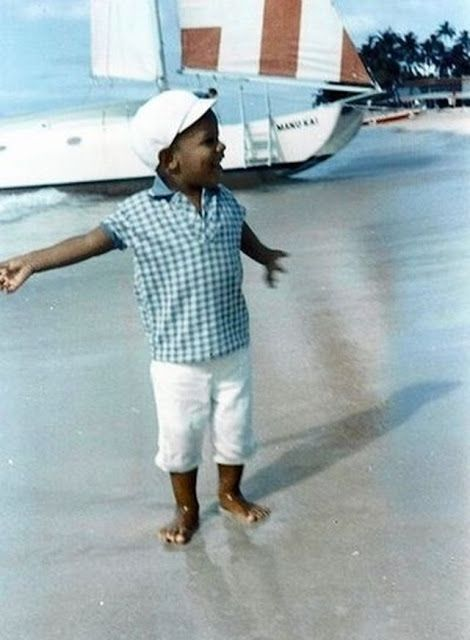 Barack walks along Waikiki Beach shortly before he and his mother moved from Hawaii to Indonesia to live with her second husband, Lolo Soetoro, in 1967.