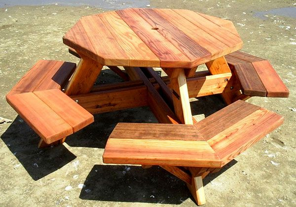 Octagonal picnic table with different shades of wood