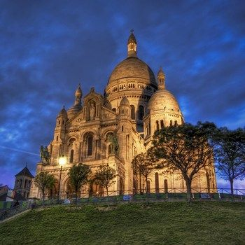 Le Sacre-Couer Basilica in Paris an amazing place to visit  - especially at dusk when you see Paris become the City of Lights