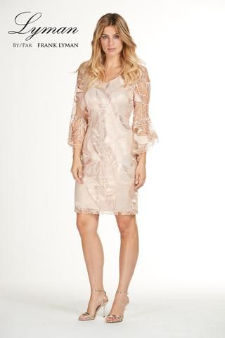 35218c8d7f11 Stunning nude lace knit cocktail dress with fashionable belle sleeves.  Proudly Made in Canada