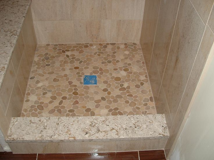 Custom shower base with sliced river stone floor and stone for Granite and tile bathroom ideas