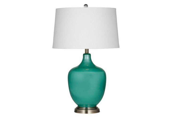 This sleek table lamp features a timeless shape in a modern turquoise hue for a perfect mix of styles.