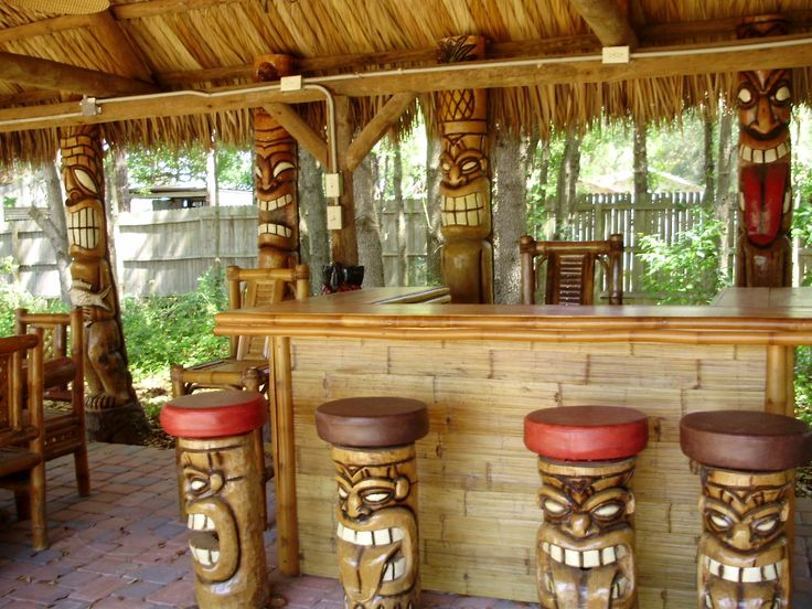 Tiki bar with carved tiki bar stools                                                                                                                                                                                 More