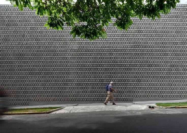 Perforated concrete walls encase La Tallera gallery by Frida Escobedo