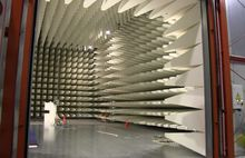 A large drive-in EMC RF anechoic test chamber. Note the orange construction cones for size reference