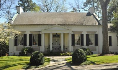 This Greek Revival house was designed and built in 1936 by Hal Hentz, of Hentz, Adler and Shutze. It was Hentz's residence in Atlanta. Hentz was originally from Florida and studied at Emory College in Oxford, Georgia. He studied architecture with Neel Reid, his eventual partner, at the Ecole des Beaux-Arts in Paris. He also studied architecture at Columbia University. Owned by Keith Summerour.
