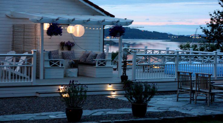 Pergola with Solvinden solar led lights from IKEA. DIY patio sofa. Utsikt over Hafrsfjord.