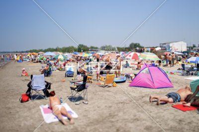 view of large group tourist enjoying at beach. -