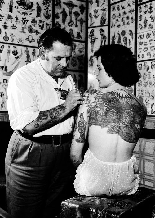 "biomedicalephemera:  Regarding the question I got about tattoo artists around the same time as Sailor Jerry (Norman Keith Collins)… It was not uncommon to see members of the Navy tattooed heavily tattooed, especially after WWII, on the West Coast. The Australian R.M. Reynolds is the tattoo artist who, along with ""Sailor Jerry"", influenced the majority of the tattoo world, well through the 1980s, and again with those who crave the ""vintage"" and ""historical""-type tattoo designs. Both R.M. ..."