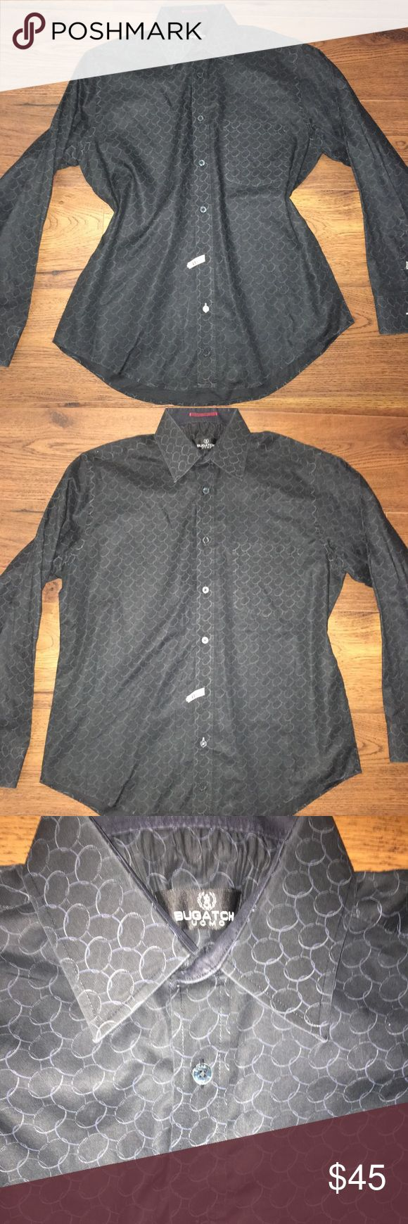 """Men's Bugatchi UOMO Dress Shirt Fresh from the dry cleaners! So crisp and structured. A very well made shirt. Button front. Front pocket. Cotton. Comes with extra buttons. Size Medium. 23"""" armpit to armpit. 22.5"""" across at waist laying flat. Aprox 29"""" long from shoulder. Sleeve is 24"""" long from shoulder. The circle design is a light blue/gray color. Please see my other men's listings. BUNDLE & SAVE 20%!! Bugatchi Shirts Dress Shirts"""